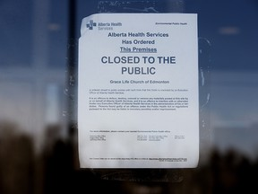 An Alberta Health Services closure order is visible posted on the front door of GraceLife Church, in Spruce Grove Friday March 5, 2021.