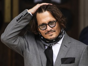 Johnny Depp arrives at the Royal Courts of Justice, Strand on July 13, 2020 in London.