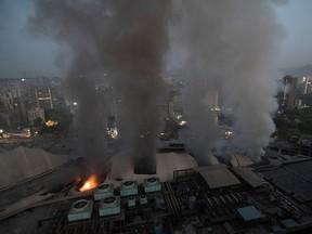 Smoke billows after a fire broke out at a hospital in Mumbai, India, March 26, 2021.