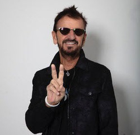 Beatles drummer Ringo Starr, 80, flashes the peace sign.