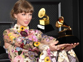 In this handout photo courtesy of The Recording Academy, Taylor Swift poses in the media room during the 63rd Annual GRAMMY Awards at Los Angeles Convention Center on March 14, 2021 in Los Angeles.