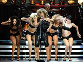 In this file photo taken on March 16, 2009, Tina Turner performs on stage at the P.O.P.B in Paris.