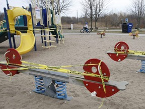 A children's playground at Woodbine Beach Park were taped off by the City of Toronto due to COVID-19 restrictions, March 26, 2020.