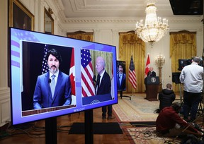 U.S. President Joe Biden and Prime Minister Justin Trudeau, appearing via video conference call, give closing remarks at the end of their virtual bilateral meeting from the White House in Washington, U.S. February 23, 2021.