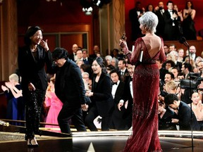 Jane Fonda gives the Best Motion Picture Oscar statue to Kwak Sin Ae and Bong Joon Ho at the 92nd Academy Awards in Hollywood, Los Angeles, California, U.S., February 9, 2020.