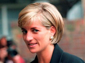 Princess Diana arrives at the Royal Geographical Society in London for a speech on the dangers of landmines throughout the world June 12, 1997.