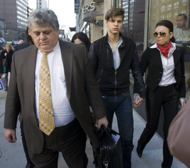 Oliver Karafa (middle), then 19, faced charges (later convicted) of criminal negligence causing death and impaired driving causing death when he was released on bail and left the College Park courts with his parents, sister and lawyer (left) on Thursday, April 5, 2012.