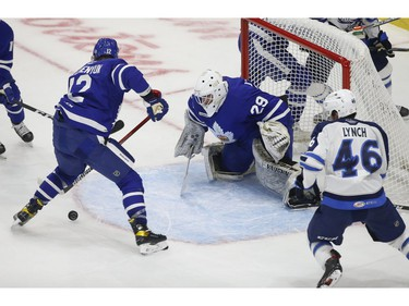 Toronto Marlies Alex Galchenyuk C (12) tries to get the puck out of the crease  in front of teammate Andrew D'Agostini G (29) during the second period in Toronto on Monday March 1, 2021. Jack Boland/Toronto Sun/Postmedia Network