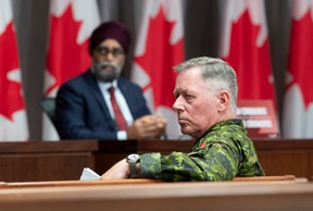 Canada's Defence Minister Harjit Sajjan and former chief of defence staff Jonathan Vance listen to a question during a news conference in Ottawa on Friday, June 26, 2020.