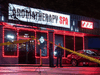 Police at the scene of a massage parlor where a person was shot and killed on March 16, 2021, in Atlanta, Georgia. Seven other people were killed at two other Atlanta spas on the same day.