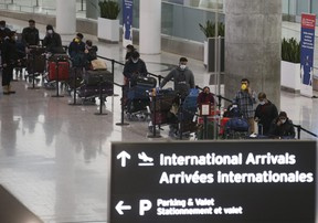 The arrivals lineup in Terminal One at Pearson International Airport February 22, 2021.