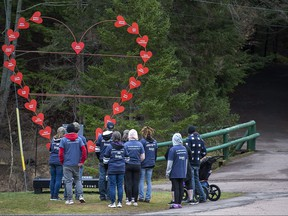 Family and friends of the late Jamie and Greg Blair gather at the Broken Heart Sculpture as they mark the one-year anniversary of the April 2020 murder rampage in rural Nova Scotia, in Truro, N.S. on Sunday, April 18, 2021.