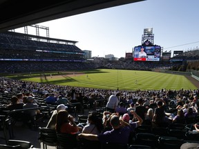 A general view of the stadium as Charlie Blackmon #19 of the Colorado Rockies catches a fly ball to end the eighth inning against the Los Angeles Dodgers on Opening Day at Coors Field on April 1, 2021 in Denver, Colorado.