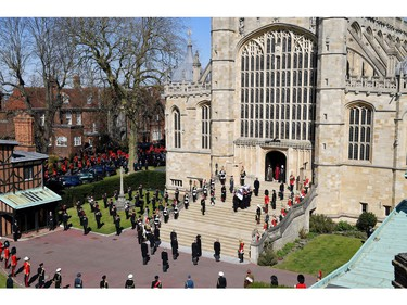 WINDSOR, ENGLAND - APRIL 17: The Duke of Edinburgh's coffin, covered with His Royal Highness's Personal Standard arrives at St George's Chapel carried by a bearer party found by the Royal Marines during the funeral of Prince Philip, Duke of Edinburgh at Windsor Castle on April 17, 2021 in Windsor, England. Prince Philip of Greece and Denmark was born 10 June 1921, in Greece. He served in the British Royal Navy and fought in WWII. He married the then Princess Elizabeth on 20 November 1947 and was created Duke of Edinburgh, Earl of Merioneth, and Baron Greenwich by King VI. He served as Prince Consort to Queen Elizabeth II until his death on April 9 2021, months short of his 100th birthday. His funeral takes place today at Windsor Castle with only 30 guests invited due to Coronavirus pandemic restrictions.