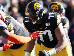 Offensive tackle Alaric Jackson, from Windsor, Ont., is shown here in action for the University of Iowa Hawkeyes. A four-year starter, the hulking lineman maintains that he is more of an athlete than people give him credit for.
