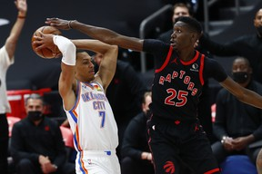 Raptors' Chris Boucher (right) defends Oklahoma City Thunder's Darius Bazley during the second half at Amalie Arena on Sunday, April 19, 2021.