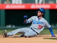 Los Angeles Dodgers centre fielder Cody Bellinger slides safely into second during a game against the Colorado Rockies at Coors Field.