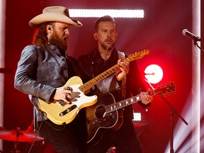 """Brothers Osborne perform """"Dead man's curve"""" during the 56th Academy of Country Music Awards (ACM) at the Ryman Auditorium in Nashville, April 18, 2021."""