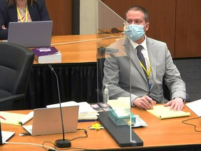 Former Minneapolis police officer Derek Chauvin attends the fourth day of his trial for second-degree murder, third-degree murder and second-degree manslaughter in the death of George Floyd in Minneapolis, Minnesota, April 1, 2021 in a still image from video.