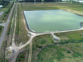 A reservoir of a defunct phosphate plant south of Tampa, where a leak at a waste water reservoir forced the evacuation of hundreds of homes and threatened to flood the area and Tampa Bay with polluted water, is seen in an aerial photograph taken in Piney Point, Fla., Sunday, April 4, 2021.