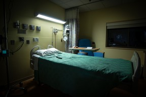 An empty hospital room is ready for the next patient.