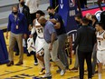 Nuggets guard Jamal Murray (27) is helped off the court after a knee injury in their game against the Warriors at Chase Center in San Francisco, Sunday, April 12, 2021.