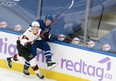 Maple Leafs' Morgan Rielly (right) battles along the boards with Ottawa Senators' Brady Tkachuk during the first period at Scotiabank Arena on Saturday, April 10.