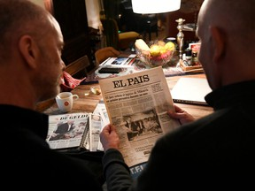 Dutch couple Gert Kasteel and Dolf Pasker look at newspaper articles that featured them on their wedding 20 years ago in the world's first legally-recognised same-sex wedding and on the state of LGBT rights two decades on, in Weesp, Netherlands March 31, 2021.