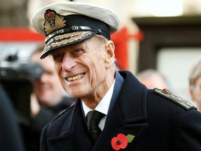 Britain's Prince Philip smiles during a service at the Field of Remembrance at Westminster Abbey in London, Nov. 8, 2012.