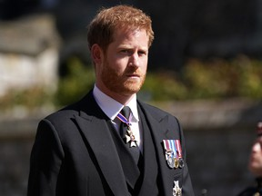 Prince Harry arrives for the funeral of Prince Philip at St George's Chapel at Windsor Castle on April 17, 2021 in Windsor, England.