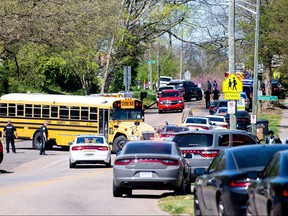 Police attend a shooting at Austin-East Magnet High School in Knoxville, Tenn., April 12, 2021.