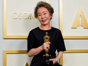 "Yuh-Jung Youn, winner of the award for Best Actress in a Supporting Role for ""Minari"", poses in the Oscars press room, at the 93rd Academy Awards in Los Angeles, Sunday, April 25, 2021."