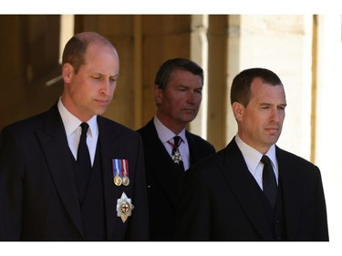 Britain's Prince William, Duke of Cambridge and Peter Phillips look on during the funeral of Britain's Prince Philip, husband of Queen Elizabeth, who died at the age of 99, in Windsor, Britain, April 17, 2021. Chris Jackson/Pool via REUTERS ORG XMIT: GDN
