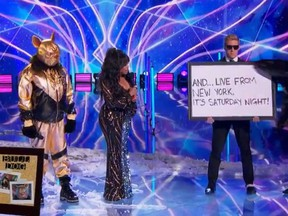 """Nick Cannon, left, is dressed as the Bulldog on Fox's """"The Masked Singer."""""""