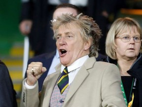 Rod Stewart reacts in the stands during the match.