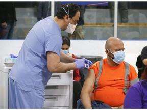 As many as 1,500 people were vaccinated with Pfizer-BioNTech COVID-19 vaccine on Wednesday at the Humber River Hospital Vaccination Clinic held at Downsview Arena on Wednesday April 21, 2021. Jack Boland/Toronto Sun/Postmedia Network