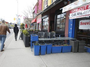 Chairs are tucked away on a patio outside a Danforth Ave. restaurant at Logan Ave.