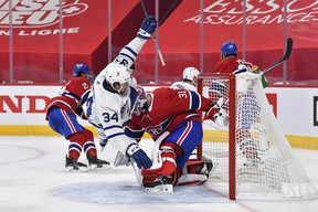 Maple Leafs centre Auston Matthews flies over Canadiens Carey in Montreal on Saturday night. Matthews' lack of production is one of the reason's Toronto finds itself having to play a Game 7, at home on Monday night.