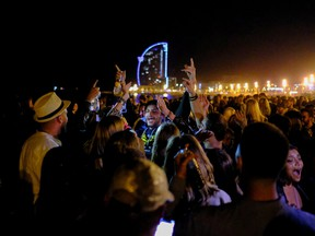 People dance at the Barceloneta beach, as the state of emergency decreed by the Spanish Government to prevent the spread of COVID-19 was lifted a week ago in Barcelona, Spain, May 16, 2021.
