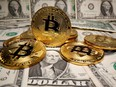 Representations of virtual currency Bitcoin are placed on U.S. Dollar banknotes in thisRepresentations of virtual currency Bitcoin are placed on U.S. Dollar banknotes in this illustration taken May 26, 2020.  illustration taken May 26, 2020.