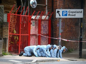Forensic officers work at the area after Sasha Johnson, a Black Lives Matter activist, was shot in an early morning attack near her home in Peckham, London, May 24, 2021.