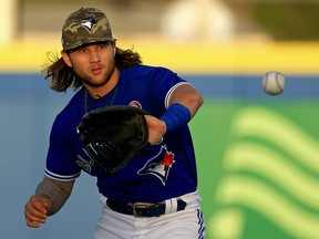 Bo Bichette of the Toronto Blue Jays fields a ball during a game against the Philadelphia Phillies at TD Ballpark on May 15, 2021 in Dunedin, Florida.