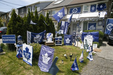 Sara Adamson, who owns a home on Merton St., displays her digs decorated to support the Toronto Maple Leafs in their upcoming playoff series on Wednesday, May 19, 2021.