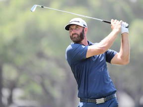 Dustin Johnson of the United States plays his shot from the 17th tee during the final round of the Valspar Championship on the Copperhead Course at Innisbrook Resort on May 2, 2021 in Palm Harbor, Fla.