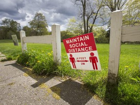 A sign warning people to stay physically distanced is seen at Flemingdon Park Golf Club in Toronto, May 10, 2021.