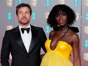 Canadian-U.S. actor Joshua Jackson and his wife British actress Jodie Turner Smith pose on the red carpet upon arrival at the BAFTA British Academy Film Awards at the Royal Albert Hall in London on Feb. 2, 2020.