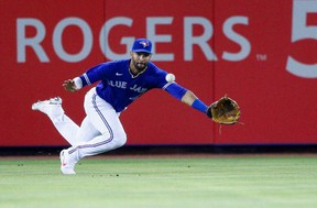 Jays left fielder Lourdes Gurriel Jr. dives for the ball against the Atlanta Braves in the fifth inning at TD Ballpark.USA TODAY Sports