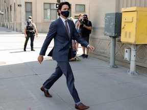 Prime Minister Justin Trudeau walks to a news conference, as efforts continue to help slow the spread of COVID-19, in Ottawa, Tuesday, May 18, 2021.