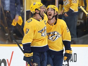 Predators defenceman Roman Josi (left) celebrates with Matt Duchene (right) after Duchene scored the game winning goal in the second overtime period for a 5-4 win against the Hurricanes in Game 3 of the First Round of the 2021 Stanley Cup Playoffs at Bridgestone Arena in Nashville, Friday, May 21, 2021.