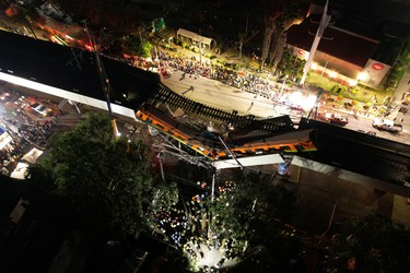 A general view of damage caused after a railway overpass and train collapsed onto a busy road in this drone picture obtained from social media Mexico City, Mexico May 4, 2021. Picture taken with a drone. INSTAGRAM @CSDRONES/via REUTERS